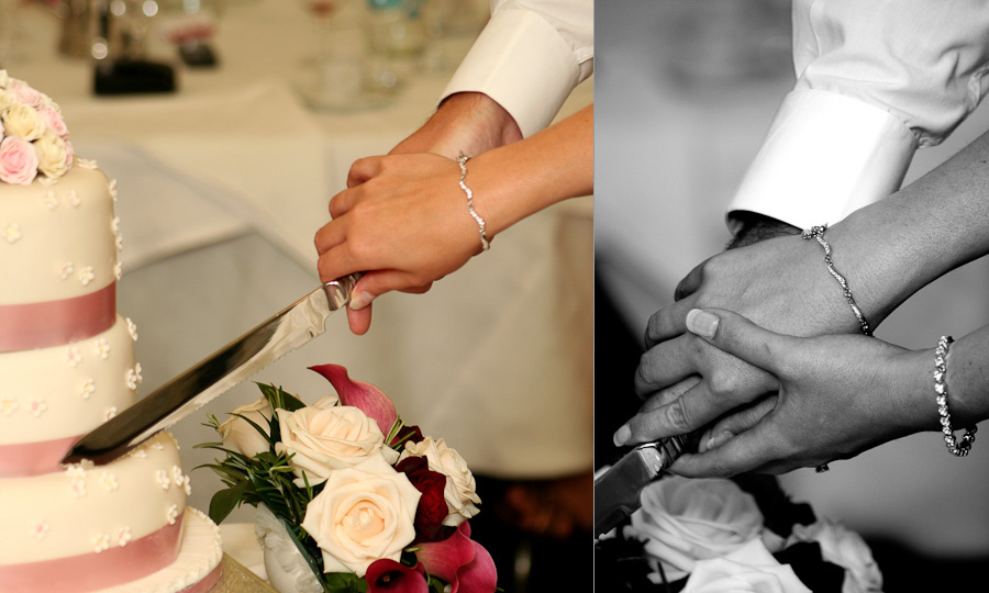 The bride and groom's hands as they cut their wedding cake