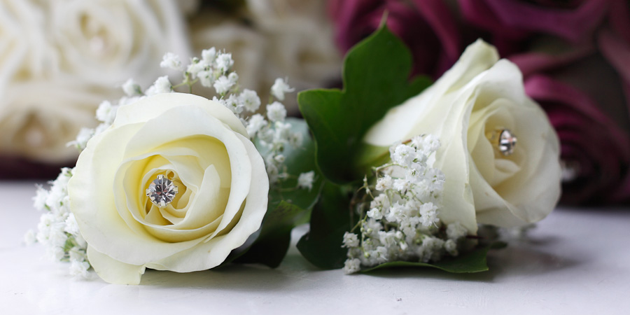 Detail photo of two wedding buttonholes