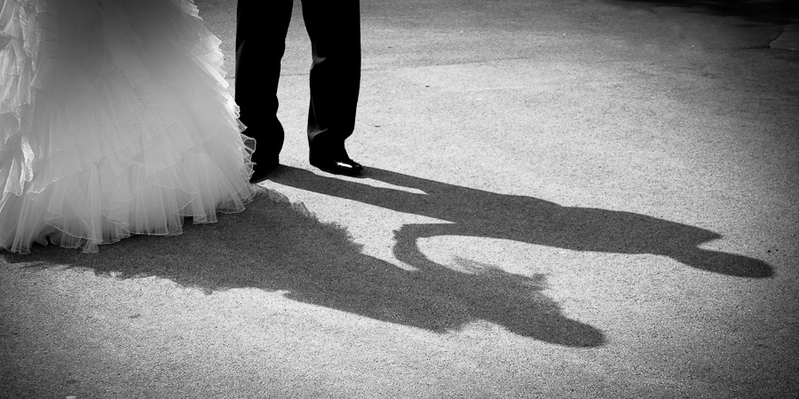 Beautifully observed wedding photograph of the bride and groom's shadows as they hold hands